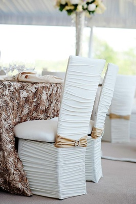 White chairs with ruched cover and rhinestone buckle