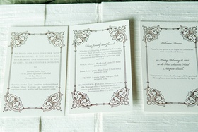 White stationery with scroll border and wedding weekend schedule
