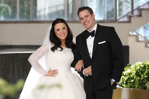 bride in long sleeve rivini lace gown, groom in classic tuxedo by tom james