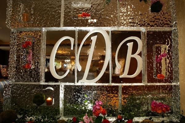 Wedding monogram ice sculpture with flowers