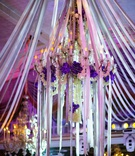 Crystal light fixture with orchids, crystals, and ribbons