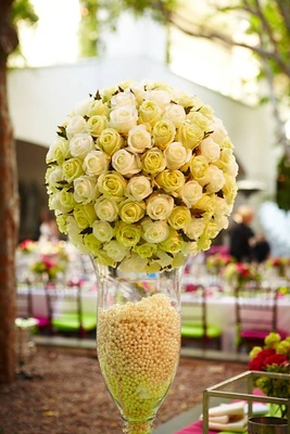 Ivory roses in vase filled with pearls