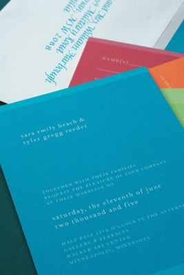 Colorful invitation, response cards, and envelope