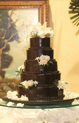 Dark chocolate wedding confection with white flowers