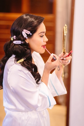 dominique gonzales chachi's world, bride puts on lip gloss before wedding