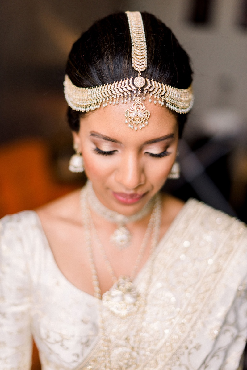 south asian bride wearing traditional gold headpiece from Sri Lanka