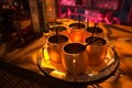 Moscow Mules in copper cups on silver tray at Moroccan-style engagement party