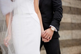 Chad Carroll wore a gold watch on his wedding day, and Jennifer Stone wore a bracelet