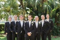 groom groomsmen triangle pose smiling white green boutonnieres florida wedding outside classic