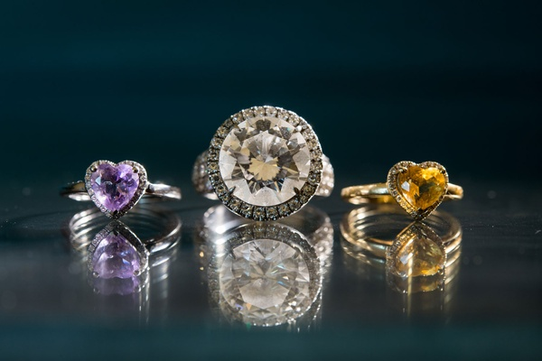 Round diamond engagement ring with halo and two rings for daughter purple and yellow heart shaped