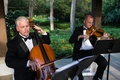 Men playing violin and cello in tuxedos