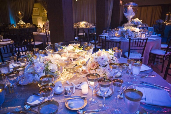 Punch bowl wedding decoration with flowers and floating candles