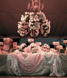 Candy bar station in draped tent for wedding reception