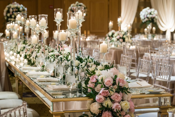 wedding reception long gold mirror table with candles and flower runner greenery pink white flowers