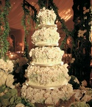 Large wedding cake covered with white sugar roses
