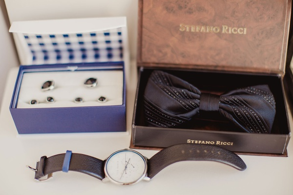 Wedding groom getting ready accessories cuff links in navy box bow tie stripe metallic and watch