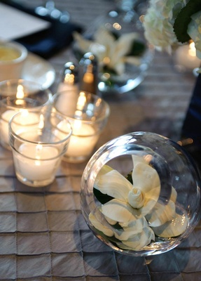 Gardenia in glass sphere vase at wedding reception