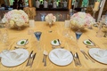 Blue toasting glasses for bride and groom at gold head table