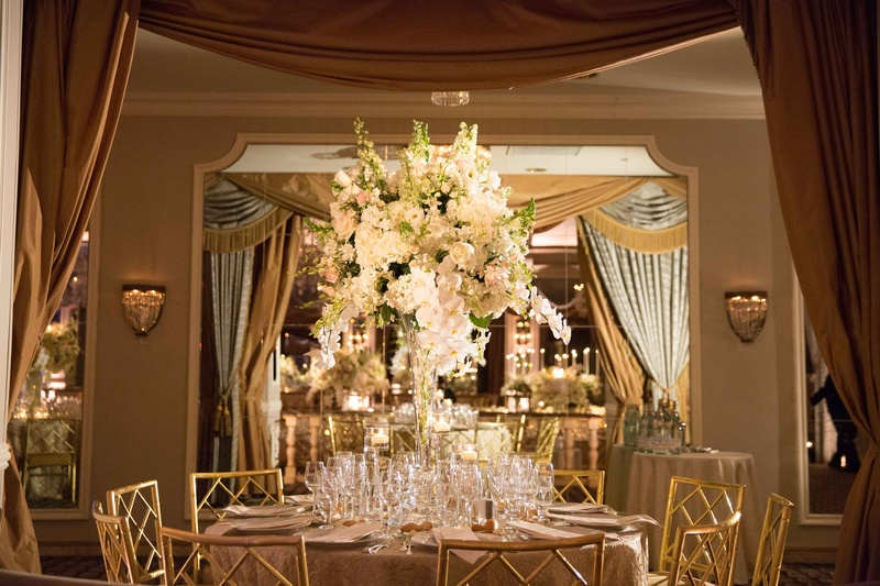 Reception dcor photos white and gold table with tall floral white and gold tablescape white linens gold chairs tall cascading floral arrangement white greenery mightylinksfo