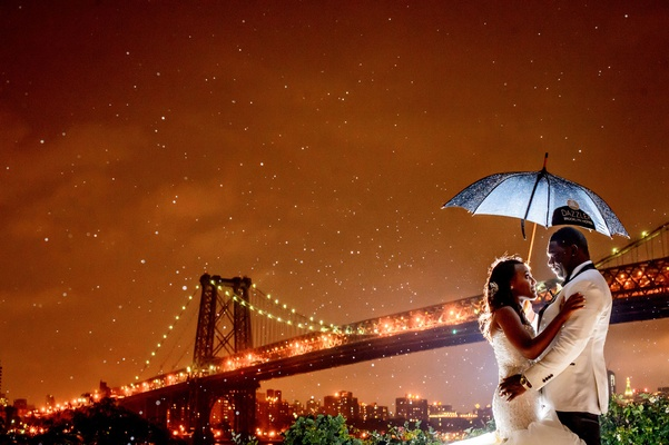 African American bride and groom with umbrella brooklyn bridge new york wedding