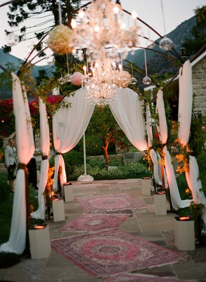 Draped entrance to outdoor reception space