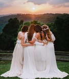 Brides in bohemian dresses by Daughters of Simone, Lindee Daniels, Mignonne Handmade embrace