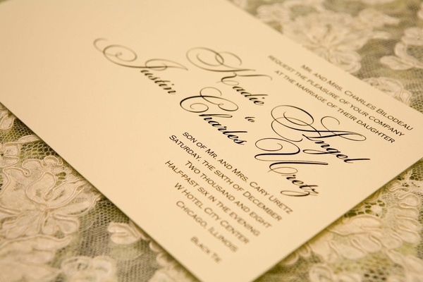 White wedding invite with blue and black calligraphy
