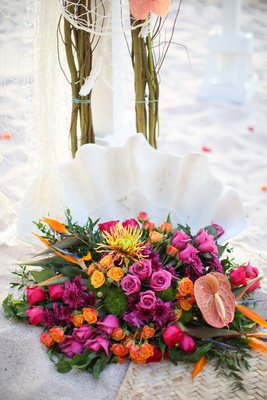 bright colorful floral arrangement sand beach destination wedding mexico pink orange yellow green