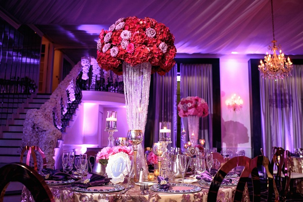 gold table linen tall centerpiece red pink purple flowers gold candle votives floating candle purple