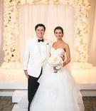 wedding portrait bride in strapless reem acra wedding dress updo groom in white tuxedo jacket