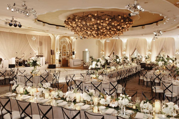 wedding reception ballroom beverly hills hotel metallic chairs white flowers greenery tropical