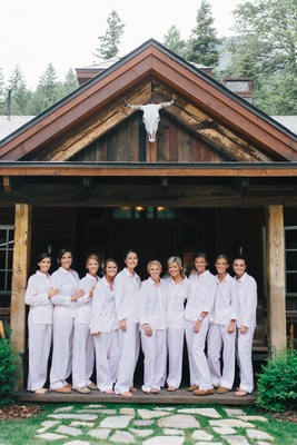 Bride and bridesmaids in long sleeve pajama clothing for getting ready sundance wedding