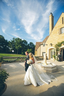 Bride walking with dad to outdoor ceremony
