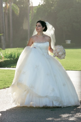 Bride in white ball gown with pearl necklace and crown