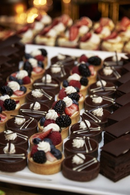 mini fruit tarts and chocolate treats at wedding dessert bar