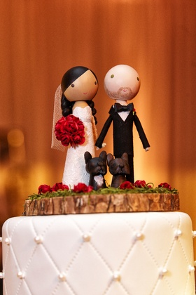 wooden figurines of bride and groom and dogs for cake topper
