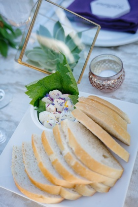 slices of sourdough bread with butter mixed with flower petals edible flowers