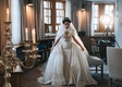 bride in sparkle pnina tornai wedding dress matching over skirt fur cape coat headpiece