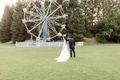 calamigos ranch wedding, bride and groom pose in front of ferris wheel