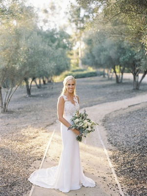 blonde bride in pronovias gown with crepe skirt and lace bodice