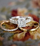 Gold diamond pave wedding band and emerald cut wedding ring