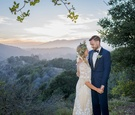 bohemian bride and groom couple gaze at each other on hilltop in santa barbara