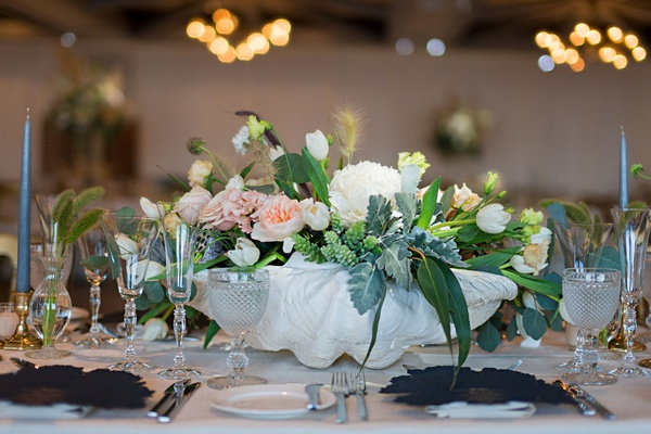 wedding reception centerpiece coastal clam shell with white peony white tulip pink garden rose
