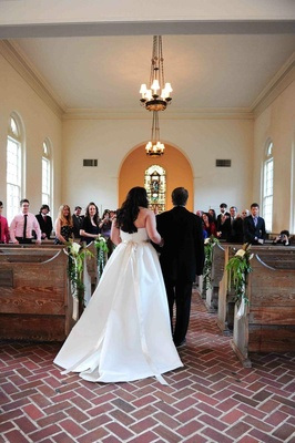Bride walks down aisle with dad at small Savannah chapel