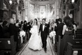 Black and white photo of newlyweds in church