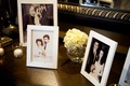 Framed old wedding portraits on table at ceremony