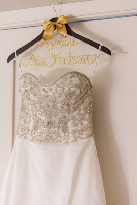 Bridal gown with beaded bodice on personalized hanger