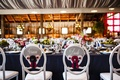 Bride and groom chairs at long head wedding barn table