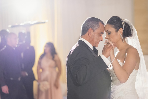 Bride in a strapless Mark Zunino dress dances with father in a black tuxedo