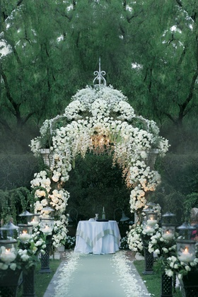 Gazebo decorated with white flowers and chandelier for a wedding